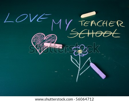 Love my teacher written on green chalkboard in school - stock photo