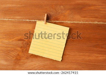 love note on the pin on wooden background