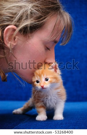 Love of the girl to a red kitten - stock photo