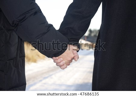 Love - older couple holding hands  taking a walk outside