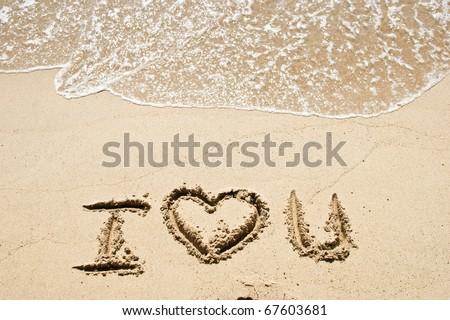 Love on the sand of a ceach - stock photo