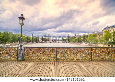Love padlocks on Pont des Arts bridge, Seine river in Paris. France, Europe. - stock photo