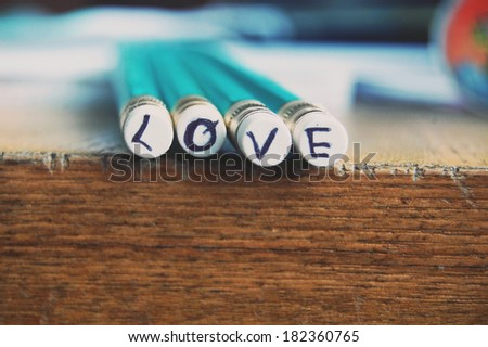 Love pencils letter on rubber