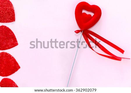 Love postcard on Valentines day. Red handmade hearts and one red heart with lace on pink background. - stock photo