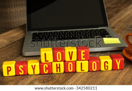 Love Psychology written on a wooden cube in a office desk - stock photo