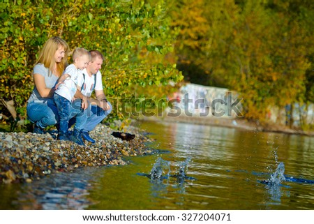 love, relationship, family, leisure, autumn - Happy family walking at the autumn nature