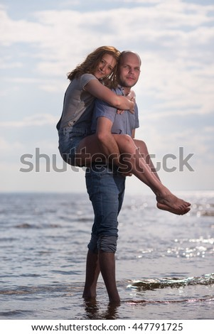 love, relationship, leisure, summer -  Happy family a husband and wife on the beach at summer day