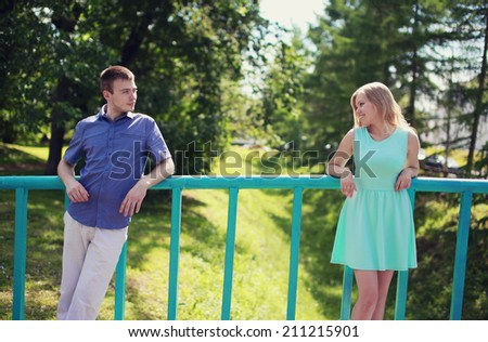 Love, relationships, dating - concept, pretty couple looking at each other on the street - stock photo
