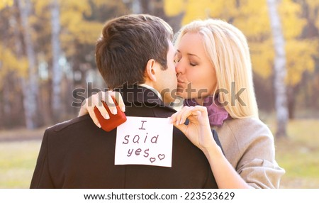 Love, relationships, engagement and wedding concept - man proposing ring woman outdoors - stock photo