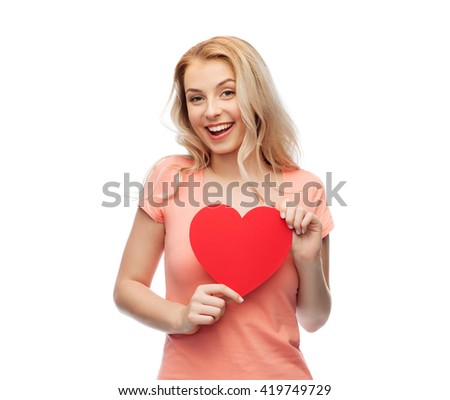love, romance, charity, valentines day and people concept - smiling young woman or teenage girl with blank red heart shape