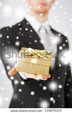 love, romance, holiday, celebration concept - man giving gift box - stock photo