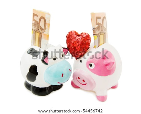 Love saving money - Piggy and Cowie money banks isolated over white. - stock photo