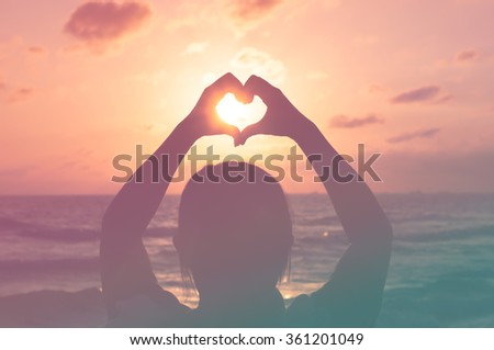 Love shape hand silhouette in sunset or sunrise period. with pantone color process - stock photo