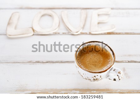 LOVE sign letters with espresso coffee in white cup,  old rustic  style table, shallow dof - stock photo