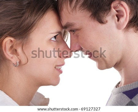 Love smiling couple looking at each other. Touching their foreheads.