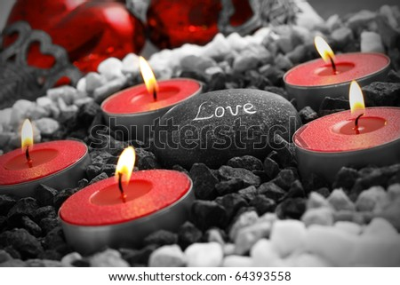 love still life with hearts cabdles and a love stone. - stock photo