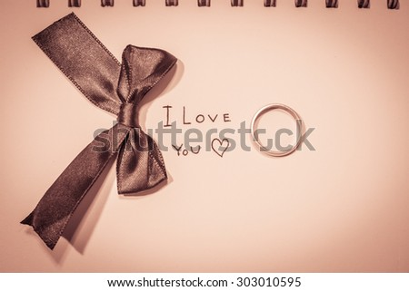 love story and note book (vintage) - stock photo
