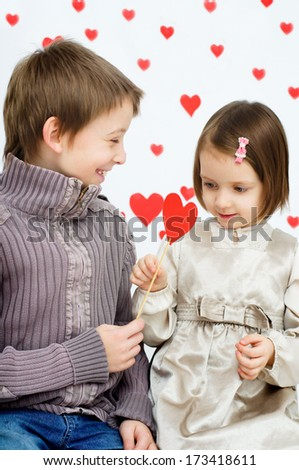 Love story.Children couple on hearts shapes rainy background for Valentine's Day and other occasions