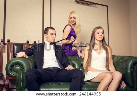 Love story for three. Love triangle where one man with two women. Love, feeling, jealousy, betrayal, betrayal, between three people. Mistress, love, sex, alcohol - of men's entertainment. Win a man. - stock photo