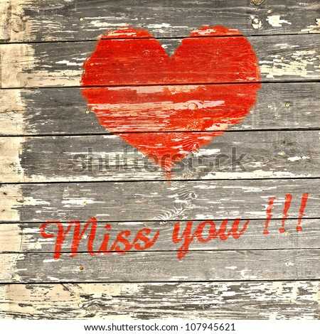love symbol and  word  miss you on old wooden wall background - stock photo