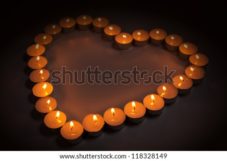 love symbol made from many small candles - stock photo