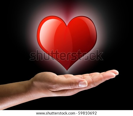 Love symbol on the palm - stock photo
