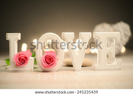 love symbol still life with letters, heart shape flowers and lights - stock photo