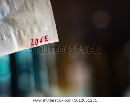 Love text on paper for background, Valentine day.