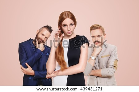 Love triangle. Young beautiful woman choose from to handsome men isolated at pink. Hard choice, lover, husband. Adultery, relationship issue, love problem concept. Girl think who to choose. - stock photo