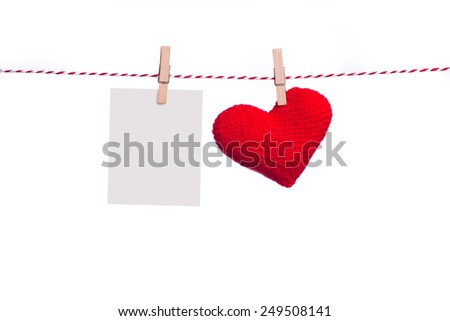 Love Valentine's hearts natural cord and clips hanging on white background, copy space - stock photo