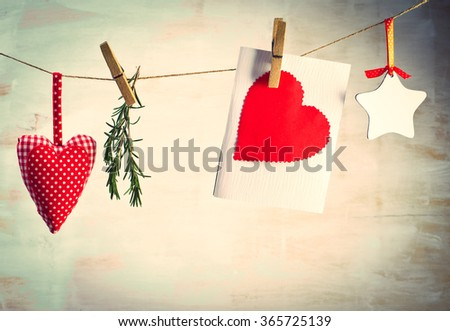 Love Valentine's hearts natural cord and red clips on rustic texture background, copy space