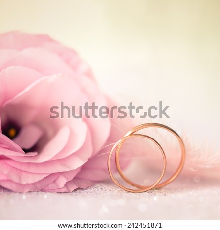Love Wedding Background with Gold Rings and Beautiful Flower - macro - stock photo