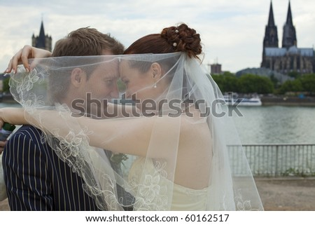 love wedding couple outdoors - cologne cathedral in background - stock photo