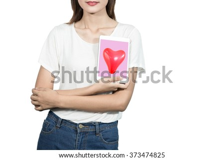 Love woman smiling holding tablet with red heart shaped balloon. Cute beautiful young woman in love. Asian female model in white t-shirt isolated on white background. For Valentines day concepts etc. - stock photo