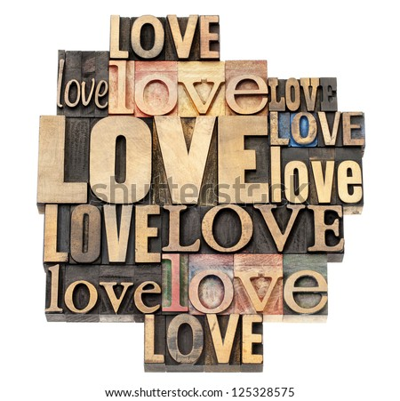 love word abstract - a collage of isolated text in vintage letterpress wood type printing blocks, a variety of fonts - stock photo