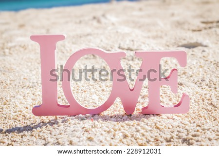 love word on natural tropical background, beach wedding concept - stock photo
