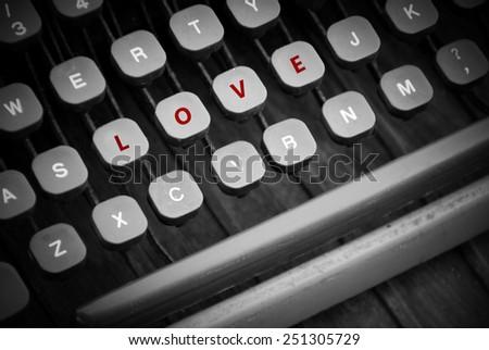 Love word on vintage typewriter keyboards, valentine's day concept - stock photo