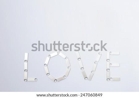 love written by memory sticks on white - stock photo
