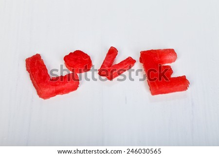 Love written of letters of watermelon - stock photo