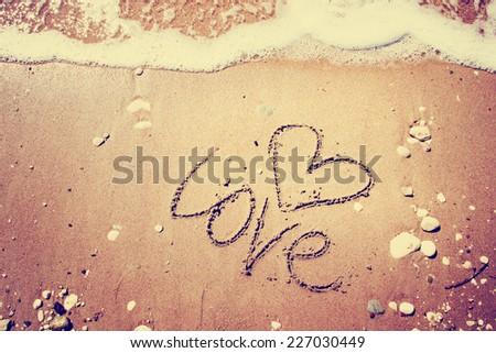 love written on the sand - stock photo