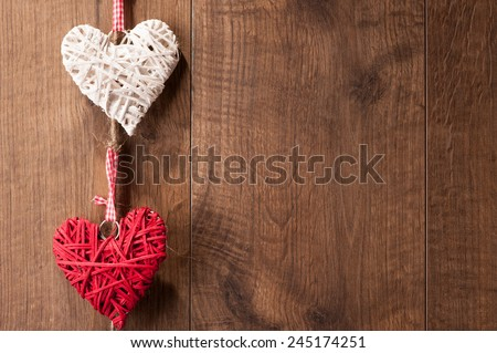 Love you. Closeup image of original composition made of decorative hearts hanging on the wall - stock photo
