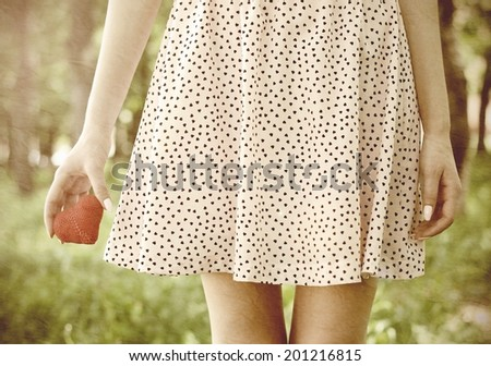 love young girl heart in hand - stock photo