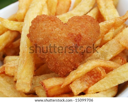 Love your food, deep fried scampi in the shape of a heart with french fries - stock photo