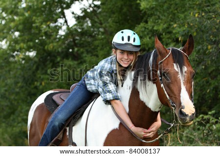 Love your horse with a hug - stock photo
