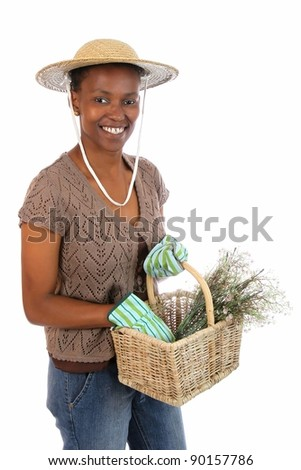 Lovely African American gardening woman with basket of flowers - stock photo