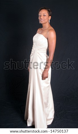 Lovely african american woman in formal dress - stock photo