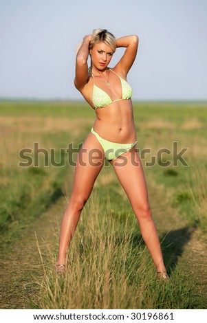 Lovely and sexy young blond girl wearing a bikini. - stock photo