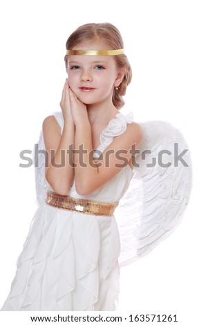 lovely angelic little girl praying to the God on Christmas holiday isolated on white background/Pretty caucasian little angel looking up and praying gratefully  - stock photo
