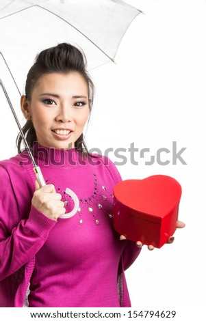 Lovely Asian girl hold gift on chirstmas day - stock photo