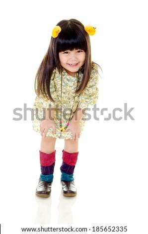Lovely asian girl posing isolated on white. kids fashion. - stock photo